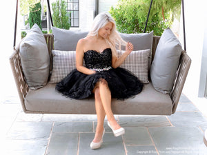 Pretty girl on swing in Adorable Black Lace Short Homecoming Dress at Rsvp Prom and Pageant, best prom dress store, Atlanta, Georgia