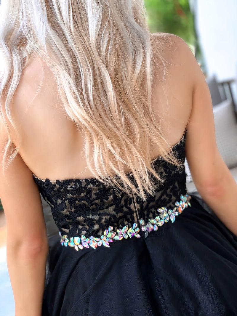 Back of bodice of Adorable Black Lace Short Homecoming Dress at Rsvp Prom and Pageant, best prom dress store, Atlanta, Georgia