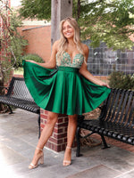 This rich emerald green color looks fabulous on any skin tone! Its sweetheart bodice is covered with emerald and clear rhinestones. Perfect for homecoming or sweet sixteen and it's at Rsvp Prom and Pageant, your source for the HOTTEST dresses, located in Atlanta, Georgia!