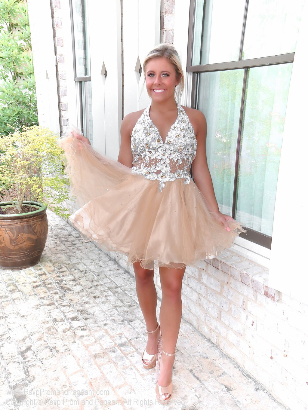 Pretty girl in a Super Sweet Short Homecoming Dress with Silver Halter Top at Rsvp Prom and Pageant, the best prom dress store, Atlanta, Georgia
