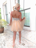 Back of model in a Super Sweet Short Homecoming Dress with Silver Halter Top at Rsvp Prom and Pageant, the best prom dress store, Atlanta, Georgia