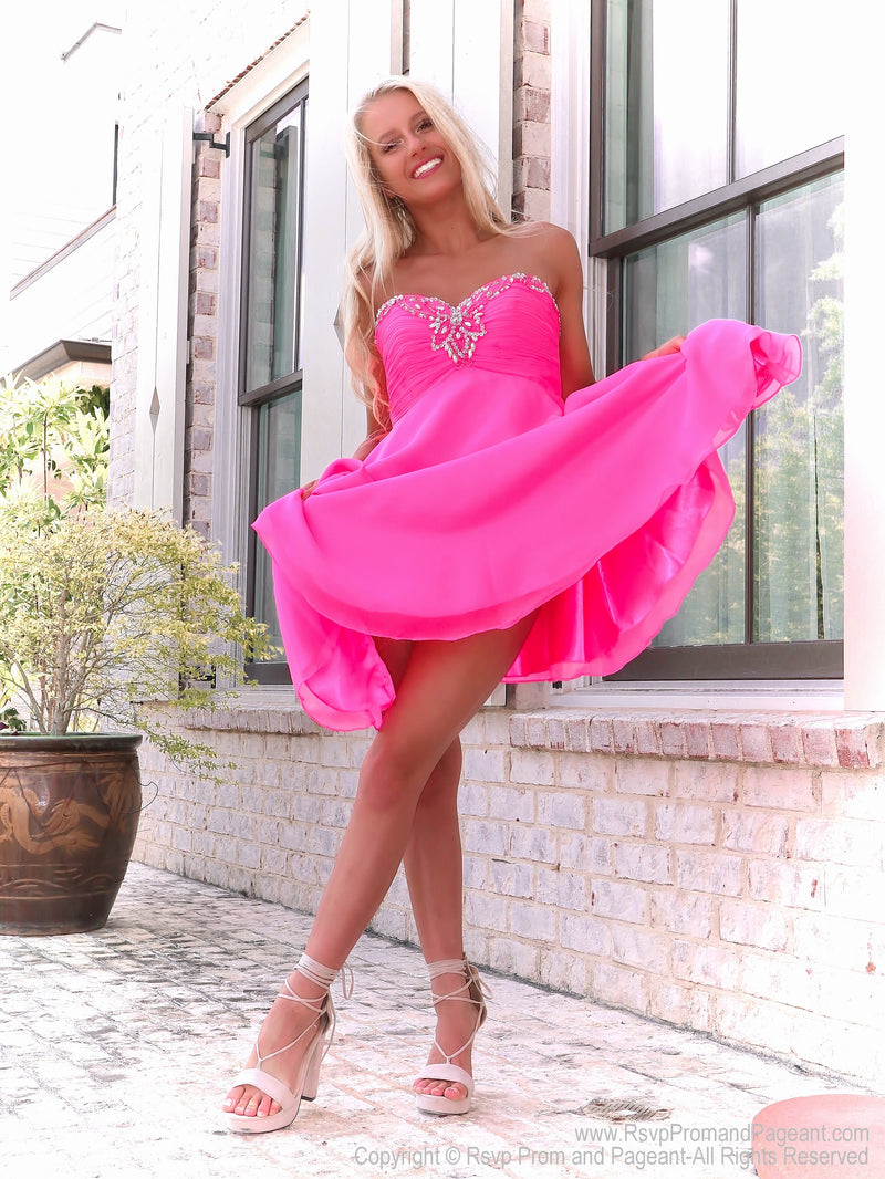 Pretty blonde in Flirty Bubblegum Pink Chiffon Short Dress at Rsvp Prom and Pageant, Best prom dress store, Atlanta, Georgia