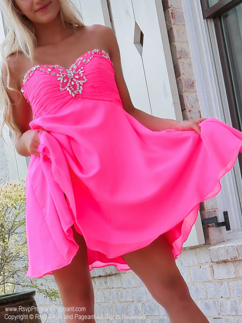 Closeup of Flirty Bubblegum Pink Chiffon Short Dress at Rsvp Prom and Pageant, Best prom dress store, Atlanta, Georgia