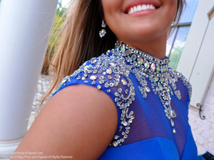 Beaded cap sleeves on an elegant royal blue formfitting dress. The high illusion sweetheart neckline features sparkling crystal beadwork cascading over the cap sleeves and an open back to complete this fabulous look! And it's at Rsvp Prom and Pageant, your source for the HOTTEST cocktail, homecoming, prom and pageant dresses located in metro Atlanta, Georgia!