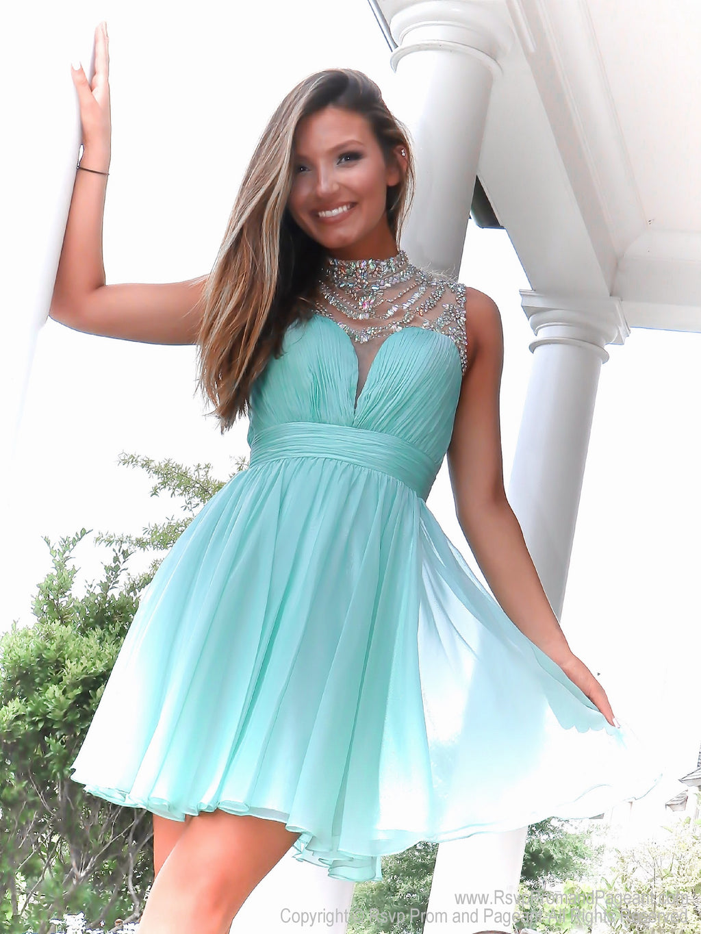 Pretty brunette in Adorable Mint High Illusioned Neckline Homecoming Dress at Rsvp Prom and Pageant, best prom dress store, Atlanta, Georgia