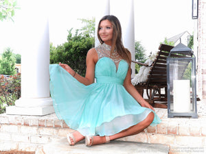 Pretty girl sitting in Adorable Mint High Illusioned Neckline Homecoming Dress at Rsvp Prom and Pageant, best prom dress store, Atlanta, Georgia