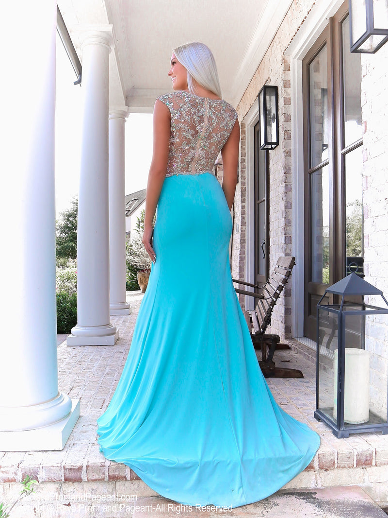 Back of Model in a gown that's Simple elegance with a sexy flair is what this gorgeous jersey style gown is all about! And it's at Rsvp Prom and Pageant, your source for the HOTTEST Prom and Pageant Dresses and exclusive evening gowns and located in Atlanta, Georgia!