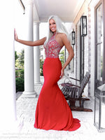 Beautiful blonde in a gorgeous gown with its beaded high choker neck and a jersey formfitting skirt, and it's at Rsvp Prom and Pageant, your source of the HOTTEST Prom and Pageant Dresses and exclusive evening gowns and located in Atlanta, Georgia!