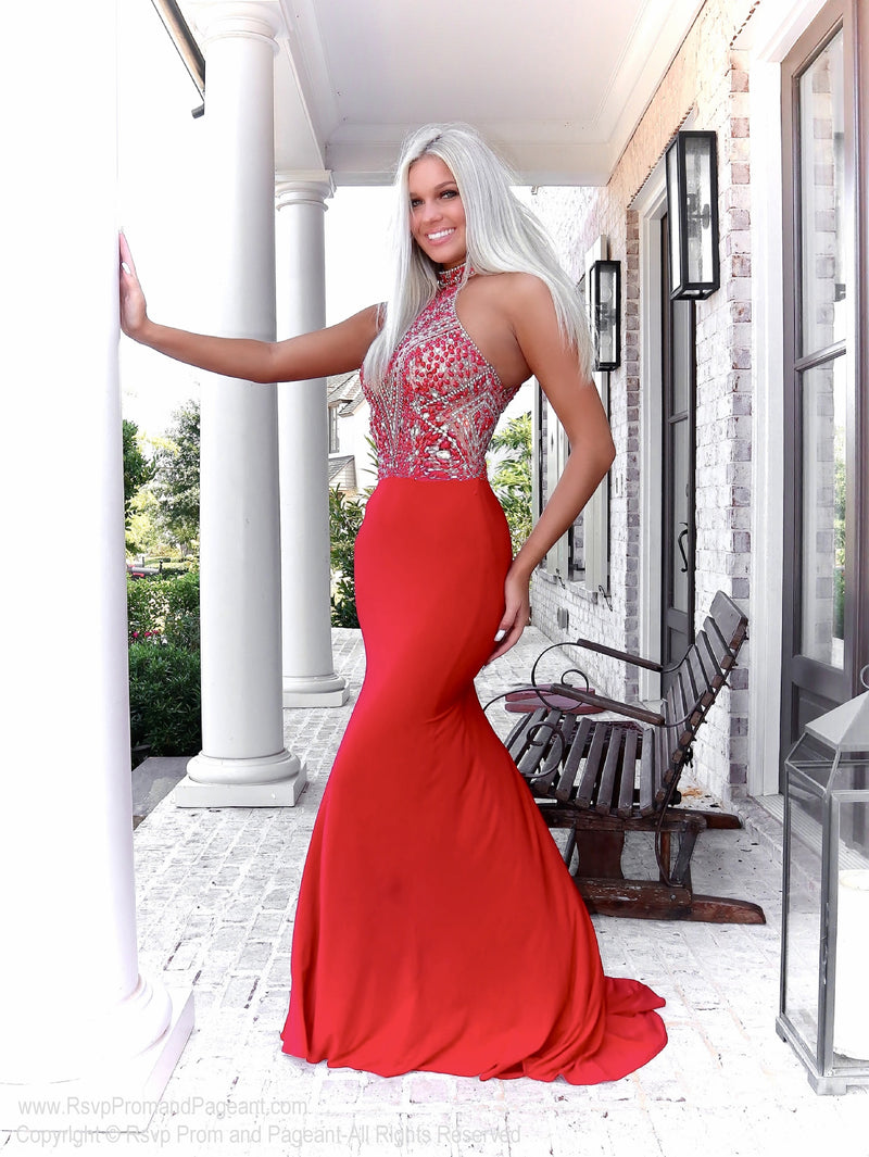 Close up of Beautiful blonde in a gorgeous gown with its beaded high choker neck and a jersey formfitting skirt, and it's at Rsvp Prom and Pageant, your source of the HOTTEST Prom and Pageant Dresses and exclusive evening gowns and located in Atlanta, Georgia!