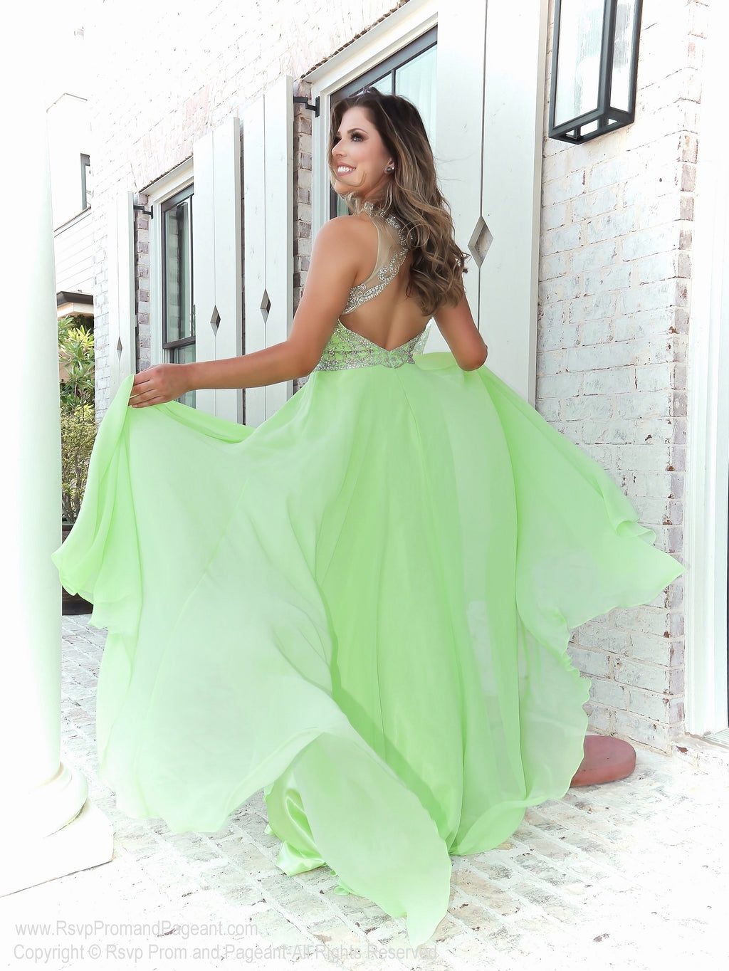 Model in in this gorgeous pastel green prom dress with an open back and flowing chiffon skirt! So elegant and it's at Rsvp Prom and Pageant, your source for the HOTTEST Prom and Pageant Dresses and exclusive evening gowns and located in Atlanta, Georgia!