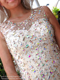 Closeup of bodice of Sophisticated Nude Form Fitting Short Dress covered with Sparkling Irisdescent stones at Rsvp Prom and Pageant, best prom dress store located in metro Atlanta, Georgia