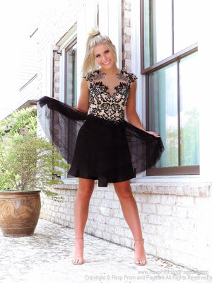 Beautiful model in this Charming Short dress with Lace-up Top and Full Tulle Shirt at Rsvp Prom and Pageant, the largest prom brand and located in metro Atlanta, Georgia