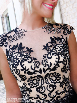Closeup of lace bodice of this Charming Short dress with Lace-up Top and Full Tulle Shirt at Rsvp Prom and Pageant, the largest prom brand and located in metro Atlanta, Georgia