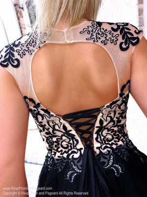 Closeup of lace-up back of this Charming Short dress with Lace-up Top and Full Tulle Shirt at Rsvp Prom and Pageant, the largest prom brand and located in metro Atlanta, Georgia