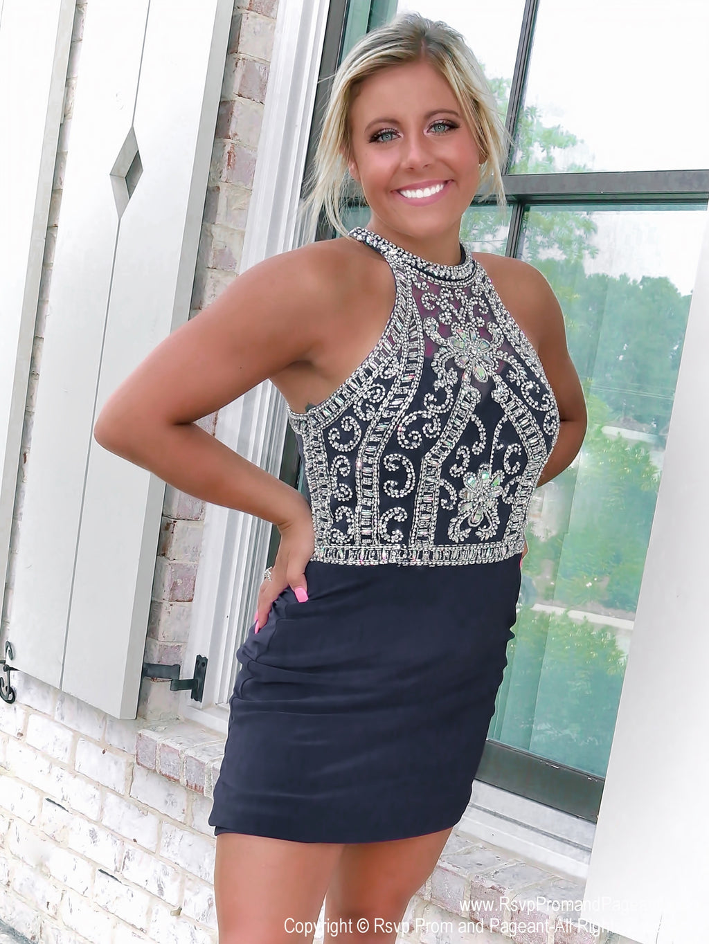 Close up of blond model in Navy Short Homecoming Dress with Spectacular Back at Rsvp Prom and Pageant, best prom dress store in the USA and located in Atlanta, Georgia!