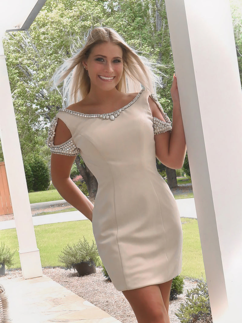 Keep it simple in this Champagne pearl adorned dress, and it's at Rsvp Prom and Pageant, your source for the HOTTEST Prom, Pageant and Cocktail Dresses, located in Atlanta, Georgia!
