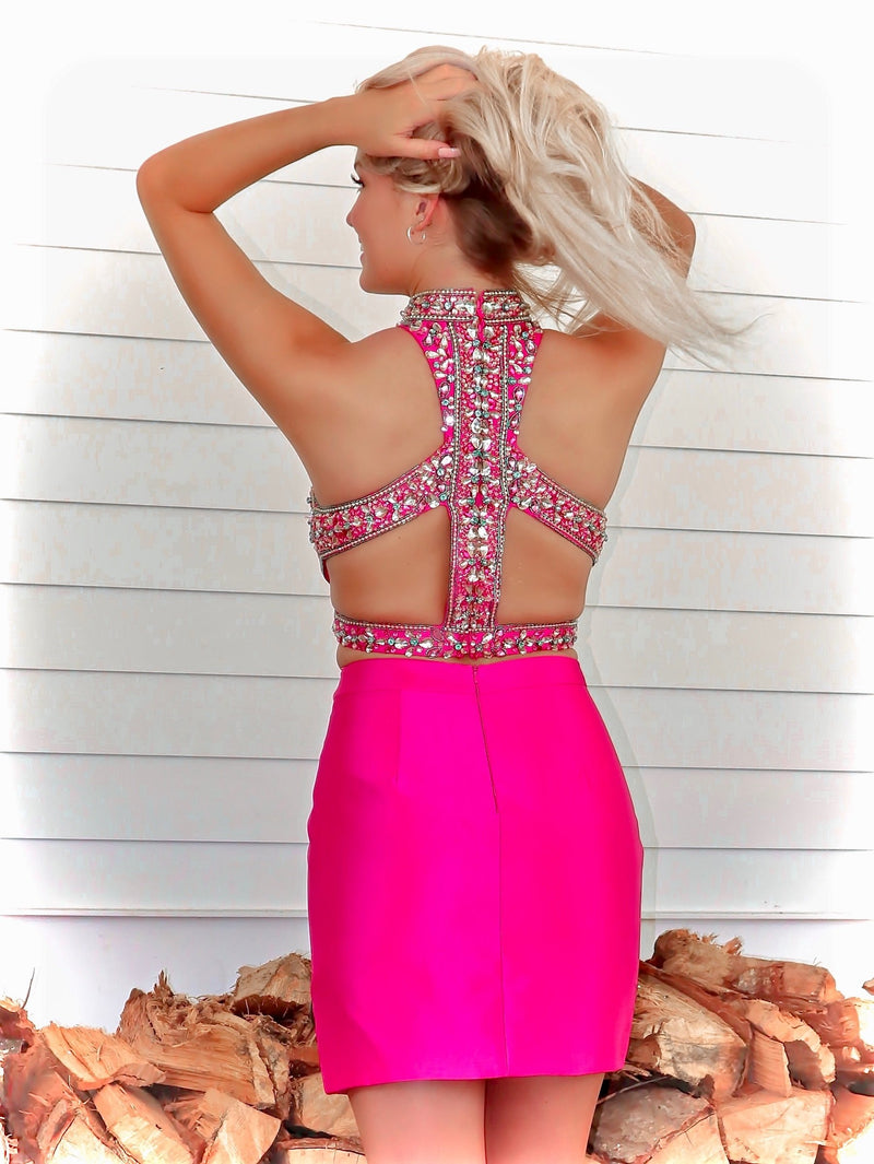 Back of model in Pretty in Hot Pink! And it's at Rsvp Prom and Pageant, your source for the HOTTEST Homecoming, Prom and Pageant Dresses and located in Atlanta, Georgia!