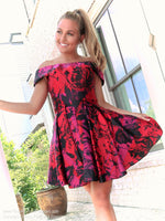 Pretty model in a dress that's perfect for brunch with the girls or a romantic date! The floral pattern is in a beautiful jewel tone that adds the right amount of richness to your look! And it's at Rsvp Prom and Pageant, your source for the Hottest Homecoming, Prom, and Pageant Dresses, Atlanta, Georgia!