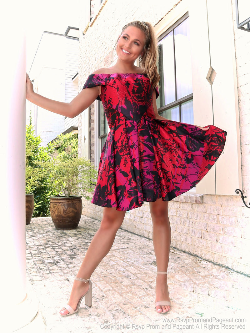 Full body shot of model in a dress that's perfect for brunch with the girls or a romantic date! The floral pattern is in a beautiful jewel tone that adds the right amount of richness to your look! And it's at Rsvp Prom and Pageant, your source for the Hottest Homecoming, Prom, and Pageant Dresses, Atlanta, Georgia!