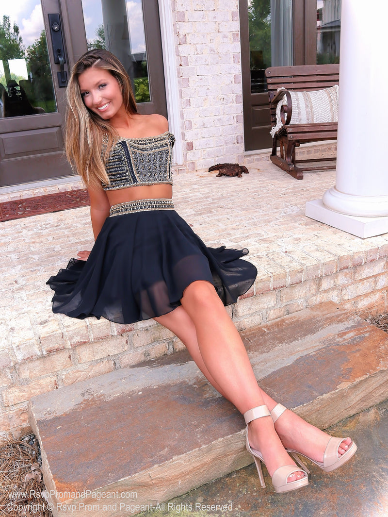 Model sitting in Super Cute Black with Gold details Two Piece Homecoming Dress at Rsvp Prom and Pageant, best prom dress store, Atlanta, Georgia