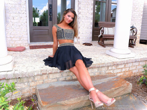 Beautiful girl in stoop in  Super Cute Black with Gold details Two Piece Homecoming Dress at Rsvp Prom and Pageant, best prom dress store, Atlanta, Georgia