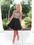 Pretty blinde model in Adorable little Black Chiffon Homecoming Dress at Rsvp Prom and Pageant, best prom dress store in Atlanta, Georgia