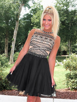 Close-up of blonde model in Adorable little Black Chiffon Homecoming Dress at Rsvp Prom and Pageant, best prom dress store in Atlanta, Georgia