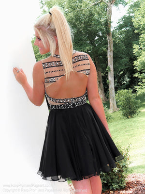 Model showing off open back of Adorable little Black Chiffon Homecoming Dress at Rsvp Prom and Pageant, best prom dress store in Atlanta, Georgia