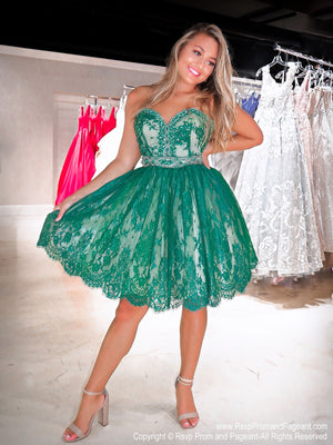 Beautiful model standing in a stunning short emerald lace dress. Emerald stones adorn the sweetheart neckline as well as the waistband and the crinoline lining gives the skirt a slight poof. Perfect for Sweet Sixteen or Homecoming. This is a ONE OF A KIND dress and ONLY at Rsvp Prom and Pageant, your source for the HOTTEST Homecoming, Prom and Pageant Dresses, Atlanta, Georgia!