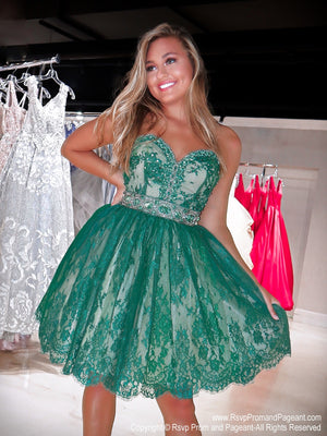 Pretty girl in a stunning short emerald lace dress. Emerald stones adorn the sweetheart neckline as well as the waistband and the crinoline lining gives the skirt a slight poof. Perfect for Sweet Sixteen or Homecoming. This is a ONE OF A KIND dress and ONLY at Rsvp Prom and Pageant, your source for the HOTTEST Homecoming, Prom and Pageant Dresses, Atlanta, Georgia!