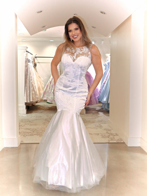 This is the ultimate of sexy, featuring a fitted bodice, an illusion open back detailed with beautiful lace and a gorgeous mermaid silhouette. And it's at Rsvp Prom and Pageant, your source for the HOTTEST prom, pageant and exclusive evening gowns and located in Atlanta, Georgia!
