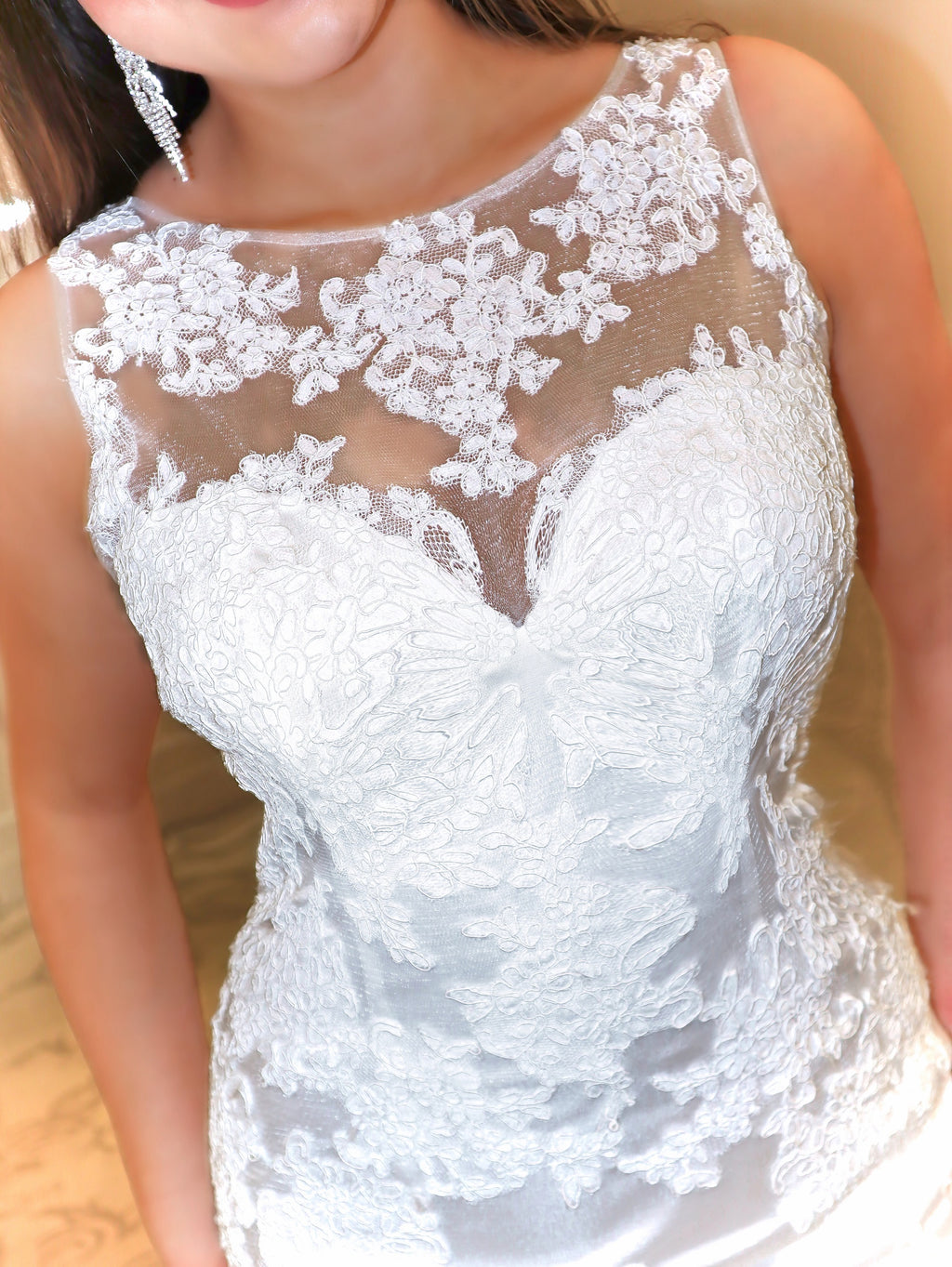 Closeup. This is the ultimate of sexy, featuring a fitted bodice, an illusion open back detailed with beautiful lace and a gorgeous mermaid silhouette. And it's at Rsvp Prom and Pageant, your source for the HOTTEST prom, pageant and exclusive evening gowns and located in Atlanta, Georgia!