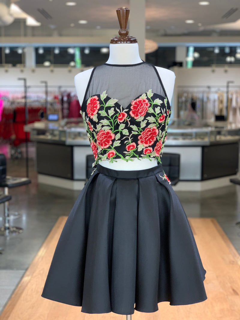 Feel like a queen in this stunning two piece short dress with a floral sweetheart and mesh halter neckline paired with a black satin skirt with pockets! And it's at Rsvp Prom and Pageant, your source for the HOTTEST Prom, Pageant and Homecoming Dresses, located in Atlanta, Georgia!