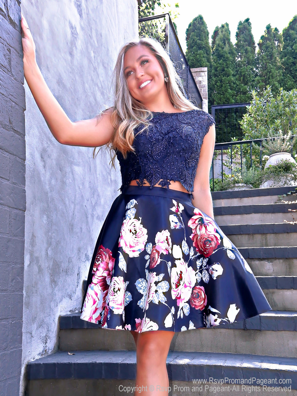 Model in Adorable Two Piece with Lace Top and Floral Skirt with Pockets Short Homecoming Dress at RsvpProm and Pageant, best prom dress store located in Atlanta, Georgia