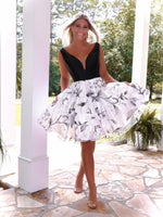 Rock everyone's world with this V-neck black satin top and white chiffon skirt with a black floral pattern short dress, and it's at Rsvp Prom and Pageant, your source for the HOTTEST Prom, Pageant and Homecoming Dresses, located in Atlanta, Georgia!