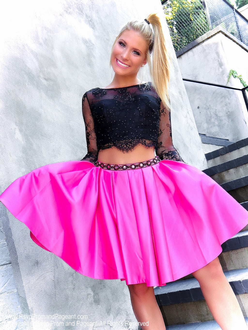 Blonde model in Fun Two Piece Short Homecoming Dress with Black Lace Top with Sleeves at Rsvp Prom and Pageant, best prom dress store located in metro Atlanta, Georgia
