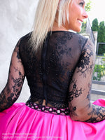 Closeup of back of Fun Two Piece Short Homecoming Dress with Black Lace Top with Sleeves at Rsvp Prom and Pageant, best prom dress store located in metro Atlanta, Georgia