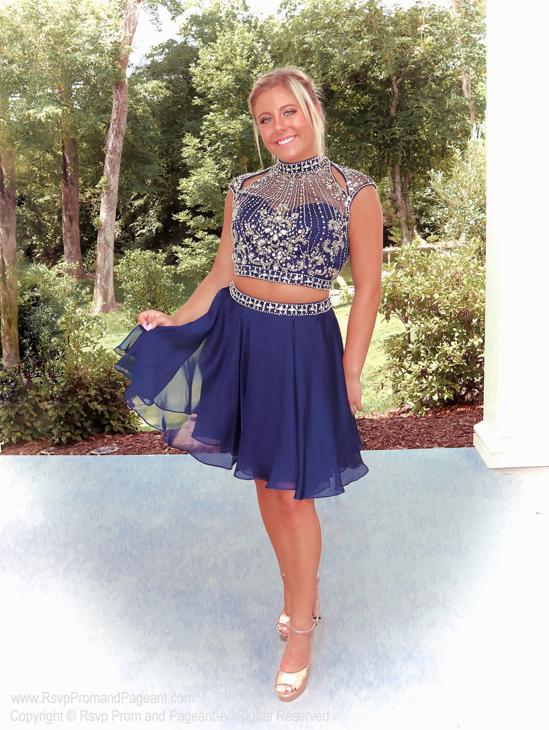 Pretty girl in beautifully Embellished Navy Two Piece Homecoming Dress at Rsvp Prom and Pageant, the largest prom dress store, Atlanta, Georgia