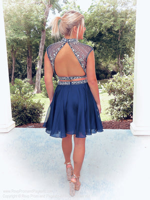 Model showing back of beautifully Embellished Navy Two Piece Homecoming Dress at Rsvp Prom and Pageant, the largest prom dress store, Atlanta, Georgia