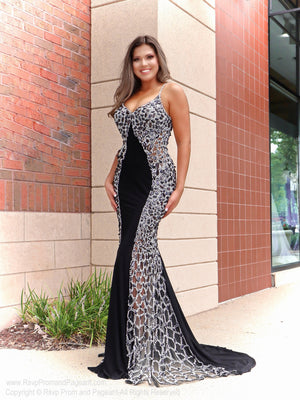 Brunette in a gorgeous gown with heavily beaded bust and sides which create an unbelievable slimming illusion and is perfect for a gala or any other formal event! And it's at Rsvp Prom and Pageant, your source for the HOTTEST prom and pageant dresses and formal evening wear and located in Atlanta, Georgia!