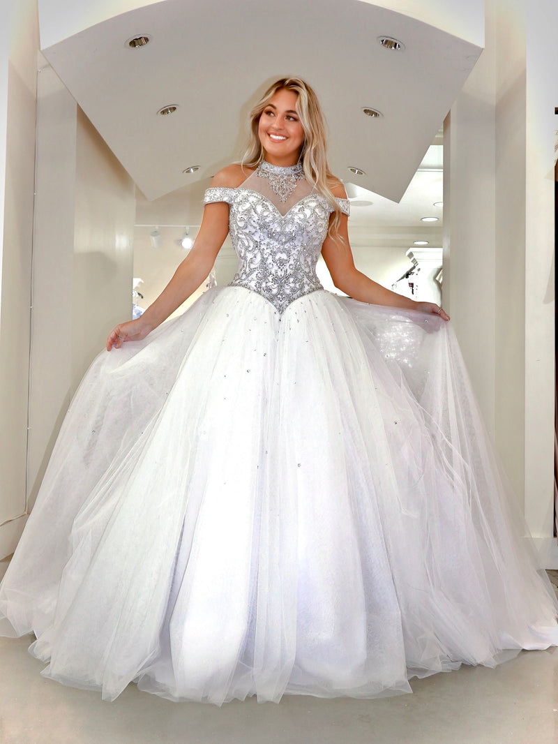 Model in this gorgeous gown was truly made for a queen! Absolutely stunning with its high neckline and beaded choker and lace-up back! And it's at Rsvp Prom and Pageant, your source for the HOTTEST Bridal, Prom and Pageant Dresses and Exclusive Evening Gowns, located in Atlanta, Georgia!