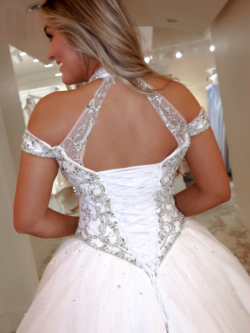 Closeup of Back of Model in this gorgeous gown was truly made for a queen! Absolutely stunning with its high neckline and beaded choker and lace-up back! And it's at Rsvp Prom and Pageant, your source for the HOTTEST Bridal, Prom and Pageant Dresses and Exclusive Evening Gowns, located in Atlanta, Georgia!