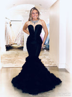 Front of Model looking like the Queen at the Ball in this jaw dropping black couture evening gown with its beaded neckline and back and long ruffled train! And it's at Rsvp Prom and Pageant, your source for the HOTTEST Prom and Pageant Dresses and Exclusive Evening Gowns and located in Atlanta, Georgia!