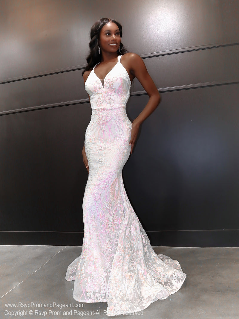 African American model in a gorgeous white gown featuring a v neckline and open back with iridescent white and light pink sequins all over! And it's at Rsvp Prom and Pageant, your source for the HOTTEST Prom and Pageant Dresses, located in Atlanta, Georgia!