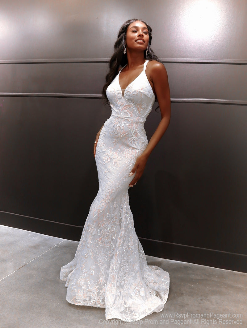 Beautiful African American model in a gorgeous white gown featuring a v neckline and open back with iridescent white and light pink sequins all over! And it's at Rsvp Prom and Pageant, your source for the HOTTEST Prom and Pageant Dresses, located in Atlanta, Georgia!