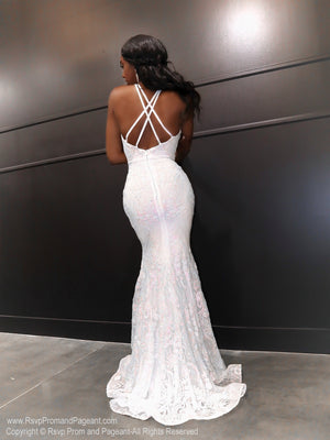 Back of African American model in a gorgeous white gown featuring a v neckline and open back with iridescent white and light pink sequins all over! And it's at Rsvp Prom and Pageant, your source for the HOTTEST Prom and Pageant Dresses, located in Atlanta, Georgia!