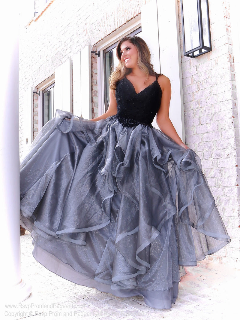 Pretty model in this fabulous black ball gown that features a sweetheart neckline and ruffles all over the silver full skirt! And it's at Rsvp Prom and Pageant, your source for the HOTTEST Prom and Pageant Dresses, located in Atlanta, Georgia!