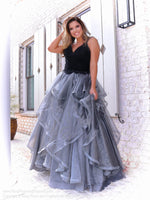 Brunette  in this fabulous black ball gown that features a sweetheart neckline and ruffles all over the silver full skirt! And it's at Rsvp Prom and Pageant, your source for the HOTTEST Prom and Pageant Dresses, located in Atlanta, Georgia!