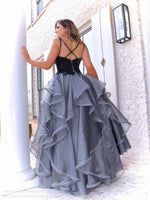 Back of model  in this fabulous black ball gown that features a sweetheart neckline and ruffles all over the silver full skirt! And it's at Rsvp Prom and Pageant, your source for the HOTTEST Prom and Pageant Dresses, located in Atlanta, Georgia!