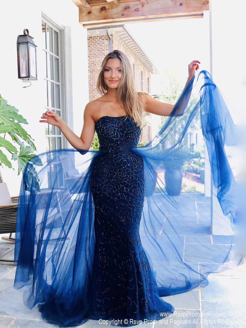 Model in this absolutely stunning strapless mermaid dress featuring navy beading all over and a soft flowing tulle overlay skirt! And it's at Rsvp Prom and Pageant, your source for the HOTTEST Prom and Pageant Dresses and exclusive evening gowns and located in Atlanta, Georgia!